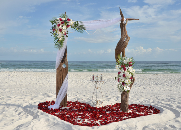 barefoot weddings, driftwood arbor, heart in the sand